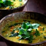 Curried Red lentil soup in pottery bowls