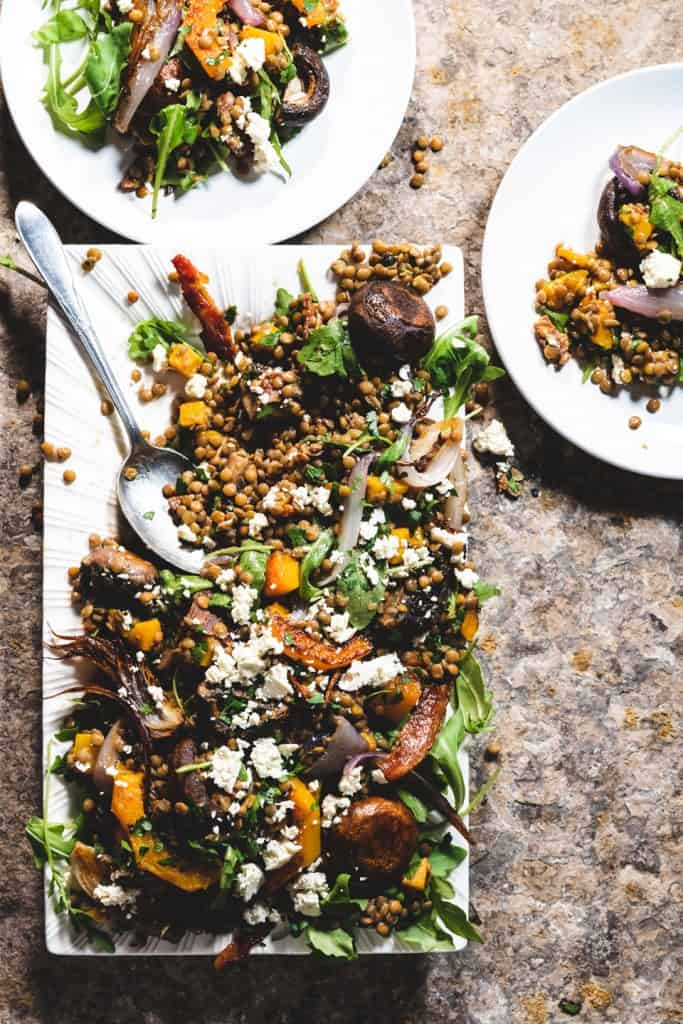 Warm Lentil Salad with roasted vegetables and bacon platter with 2 plates