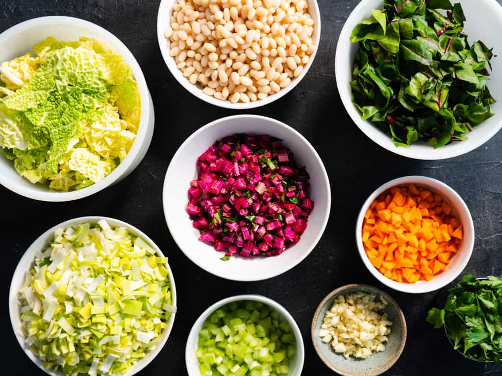 ingredients for soup in separate bowls