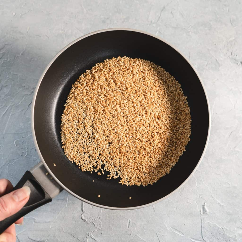 sesame seeds toasted in a saute pan