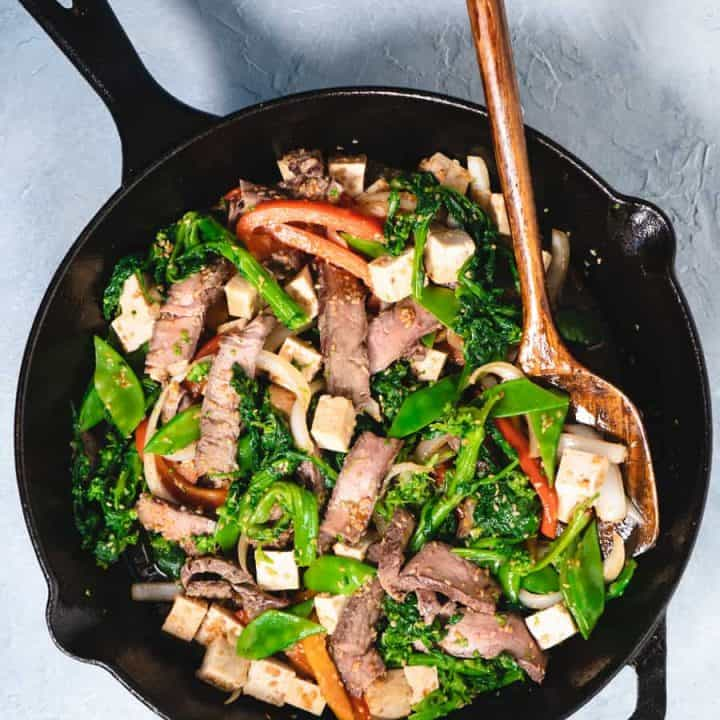 beef stir fry with broccoli rabe in cast iron skillet
