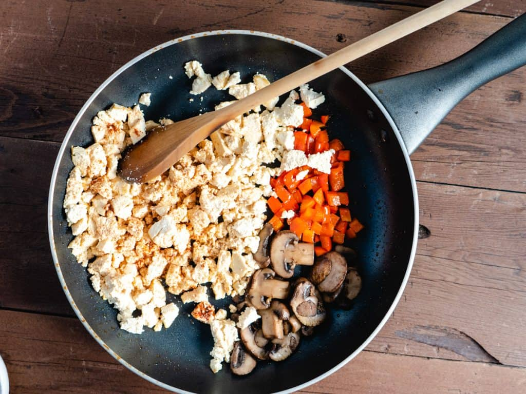 tofu scramble in saute pan before mixing together
