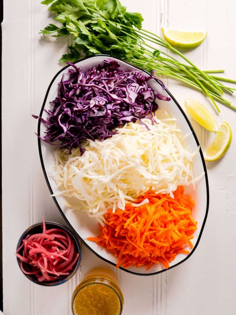 shredded cabbage, carrots and all ingredients for coleslaw