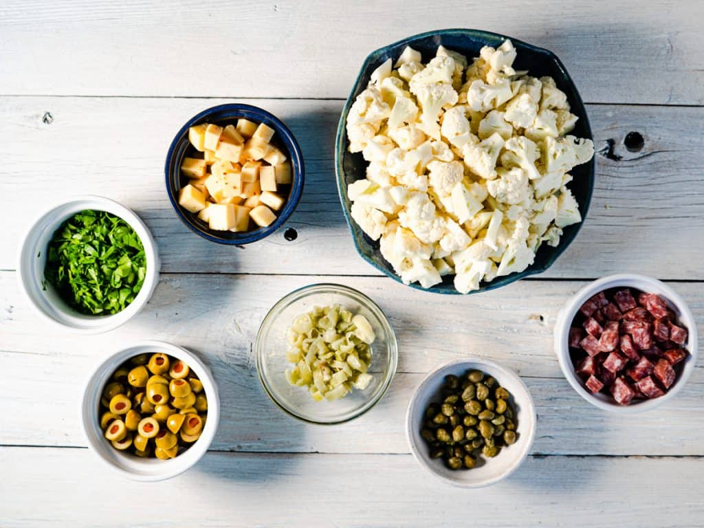 prepared ingredients for cauliflower salad on white background