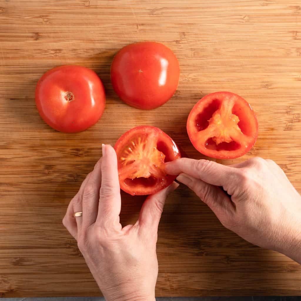 showing how to remove seeds from tomatoes