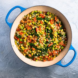 blue dish with prepared colorful summer succotash
